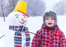 Winter fun! My friend snowman and me are in the winter snow day. Royalty Free Stock Photo