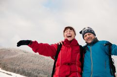 Winter fun - senior retired couple in snow. Lifestyle portrait of senior happy retired couple in outdoor winter together Stock Images