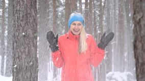 Winter fun. snow falling from tree over woman`s head stock video footage