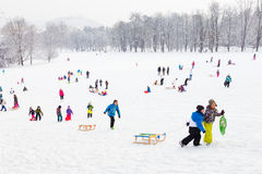 Winter fun, snow, family sledding at winter time. Royalty Free Stock Image
