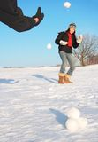 Winter fun - snowball fight. Snowball fight - winter fun. Couple throwing snowballs at each other Stock Photo