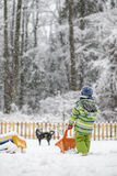 Winter fun - toddler in snow suit playing in snow Royalty Free Stock Photos