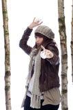 Winter fun:young woman throwing snow balls Royalty Free Stock Photos