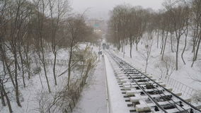 The winter funicular. KIEV, UKRAINE - JANUARY 4, 2017: The trams of the Funicular rides along the snowy slope of Mykhailivska hill from Poshtova Square to St stock video footage