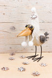 Winter funny bird. Winter decoration. Funny bird in warm hat with snowflakes Royalty Free Stock Images