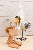 Winter funny bird. Preparations for Christmas time. Funny bird in warm hat with ginger cookies Royalty Free Stock Images