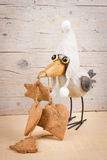 Winter funny bird. Funny bird in warm hat with ginger cookies Royalty Free Stock Image