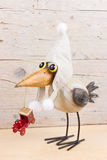 Winter funny bird. Funny bird in warm hat with old christmas decoration Stock Images