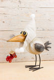 Winter funny bird. Funny bird in warm hat with old christmas decoration Royalty Free Stock Photo