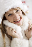 Winter fur. Smiling female in snug winter fur royalty free stock photography