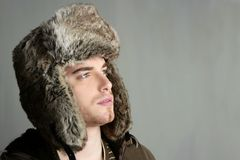 Winter fur hat portrait of fashion young man. Winter fur hat portrait of fashion young handsome man Royalty Free Stock Photo