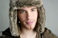 Winter fur hat portrait of fashion young man Stock Photos