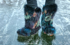 Winter fur shoes on the ice surface Stock Images