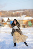 Winter games. Girl playing with snow. Winter Village. Canon 5Dmark2 Royalty Free Stock Photo
