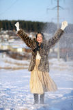 Winter games. Girl playing with snow. Winter Village. Canon 5Dmark2 Royalty Free Stock Images