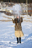 Winter games. Girl playing with snow. Winter Village. Canon 5Dmark2 Stock Image