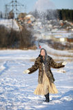 Winter games. Girl playing with snow. Winter Village. Canon 5Dmark2 Stock Images
