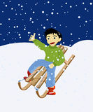 Winter games. Happy kid on a wooden snow sledge Stock Photos