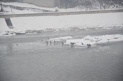Winter games on a frozen river Royalty Free Stock Images