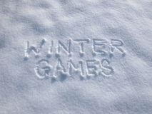 Winter Games - Snow Writing. Inscription written on the snow surface. Frosty and sunny day Royalty Free Stock Image