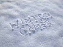 Winter Games - Writing In the Snow. Caption handwritten on the snow surface. Frosty and sunny day Royalty Free Stock Image