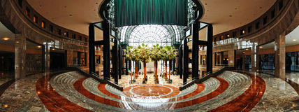 Winter Garden Atrium Panorama - New York City. The Winter Garden Atrium is a 45,000 ft glass domed pavilion housing various plants, trees and flowers, also Royalty Free Stock Images