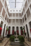 Winter garden. With balconies and marble fountain royalty free stock images
