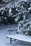Winter Garden Slumber. The garden sleeps, nestled in it`s white coating of snow and patiently awaits Spring Stock Photo