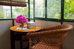 Winter Garden with Table and Books. Winter Garden with Table and Basket Chair and Books Royalty Free Stock Images