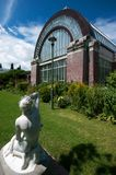 Winter Gardens Statue and Glasshouse  Royalty Free Stock Photography