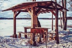 Winter gazebo on the shore of the lake royalty free stock image