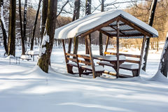 Winter gazebo in the woods. Winter wooden gazebo in a snowy forest, the concept of winter Stock Photo