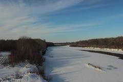 Winter gefrorener Fluss Stockfotos