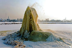 Winter geyser on sludge fields Royalty Free Stock Photography