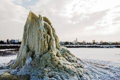 Winter geyser on sludge fields Stock Images