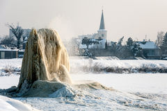 Winter geyser on sludge fields Stock Photo