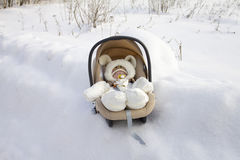 Winter gift. The girl is in the car seat stock photo