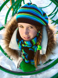 Winter girl. Winter portrait of a beautiful young woman with a cap and a scarf stock photography
