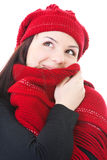 Winter girl. Girl friendly and mysterious smiling in wool scarf and looking up Royalty Free Stock Photos