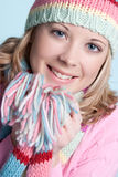 Winter Girl. Beautiful smiling blond winter girl royalty free stock photo