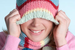 Winter Girl. Playful winter beanie hat girl stock image