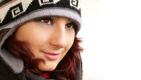 Winter girl. Red hair girl with winter hat on white royalty free stock image