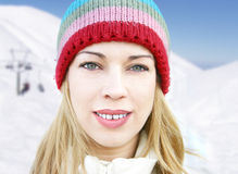 Winter girl. Winter, cold, woman, girl, women, people, season, seasons, snow, mountain, sky, snowing, beauty, beautiful, hat, clothes, face, closeup Stock Photography