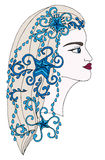 Winter girl with abstract blue décor element on the hair Stock Images