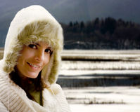 Winter girl against snowy landscape Royalty Free Stock Images