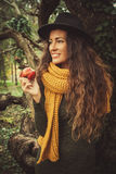 Winter girl with apple Stock Photos