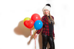 Winter girl with balloons Royalty Free Stock Images