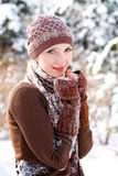Winter girl basking outdoors Stock Image
