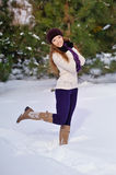 Winter girl behind snow tree Stock Images