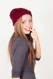 Winter girl biting finger Stock Images